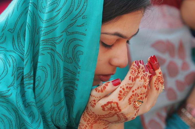 Muslim girl praying at historic Badshahi Mosque in Lahore, Pakistan.October 27,2012.